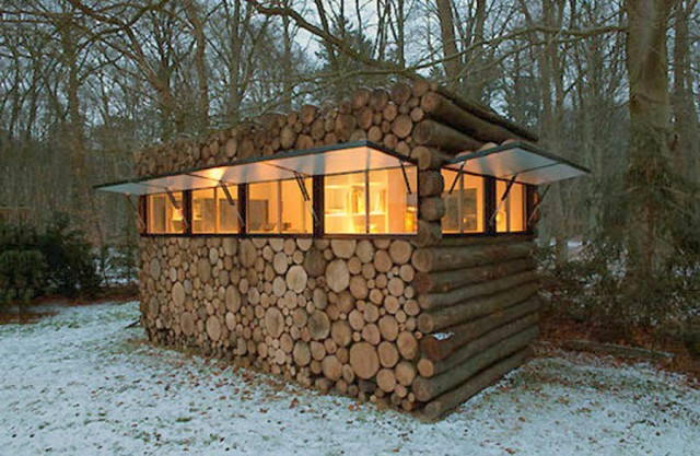 Garden shed with tree trunks