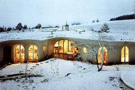 Earth house in snow