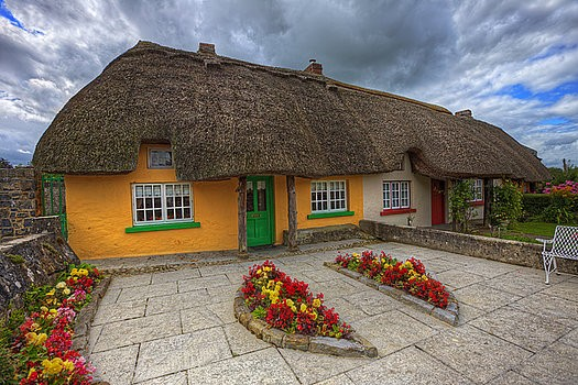 Colorful traditional  Irish cottage with thatched roof