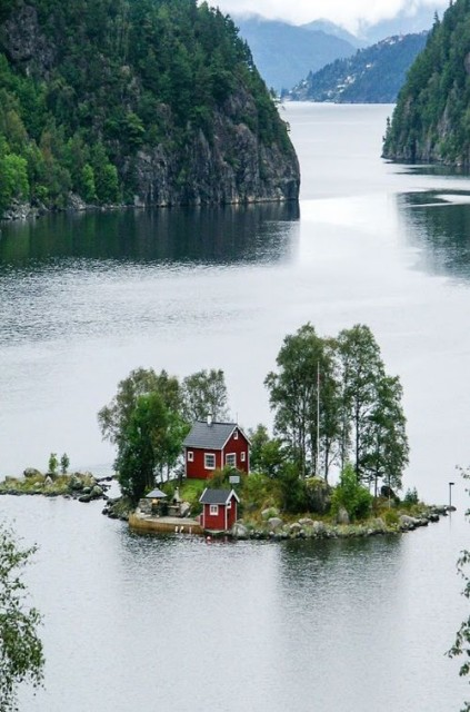 Cottage on a small island between the Norwegian fjords