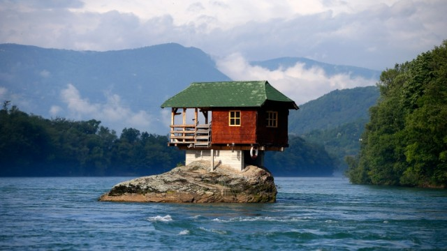 Tiny house on rock in the Drina River in Serbia