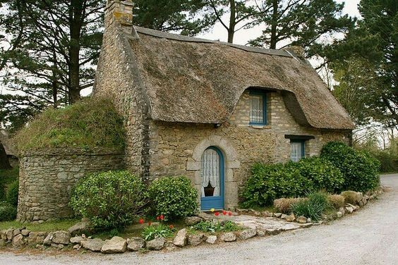 Stone house with thatched roof