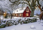 Nice wooden cottage in snow in Sweden