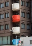 Building with balconies in the shape of teacups