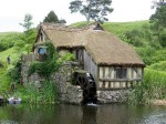 Thatched cottage complete with water wheel in Hobbiton